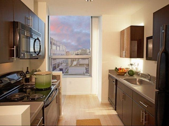 Kitchen Island With Energy Efficient Appliances at Aspira Apartments, Seattle,98101