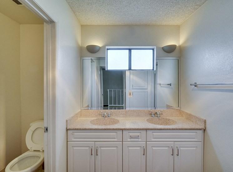 Renovated Bathrooms With Quartz Counters at Highlander Park Apts, California, 92507
