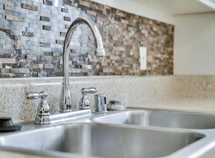 Stainless Steel Sink With Faucet at Highlander Park Apts, Riverside