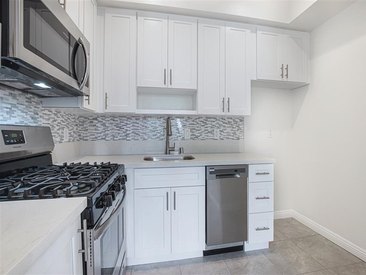 Fully Equipped Kitchen Includes Frost-Free Refrigerator, Electric Range, & Dishwasher at Hollywood Vista, Hollywood, California