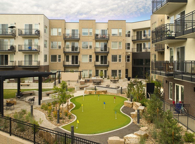 Resident Courtyard with Putting Green, BBQ and Picnic Areas at Cycle Apartments, Ft. Collins
