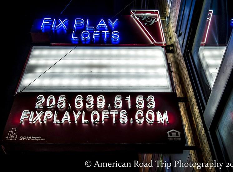 Restored historic signage outside fix play lofts