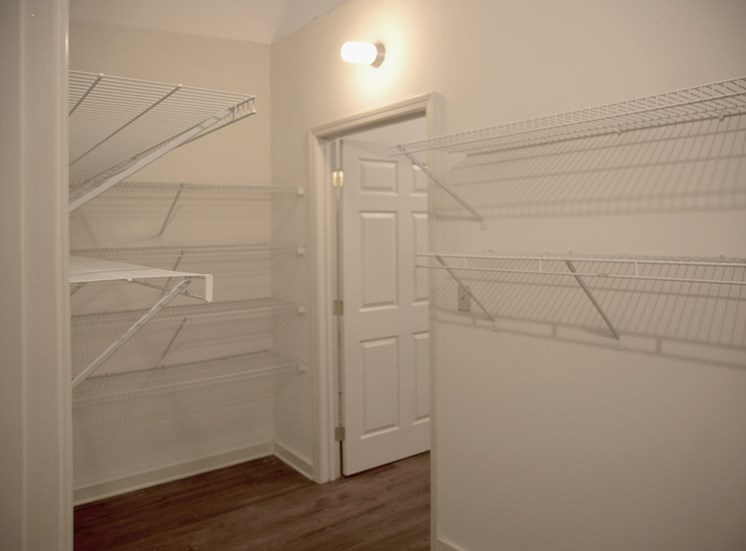 large bedroom closet with built-in wire shelving