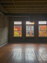 Polished wood floors and large windows in Fix Play Lofts in Birmingham, AL 35203