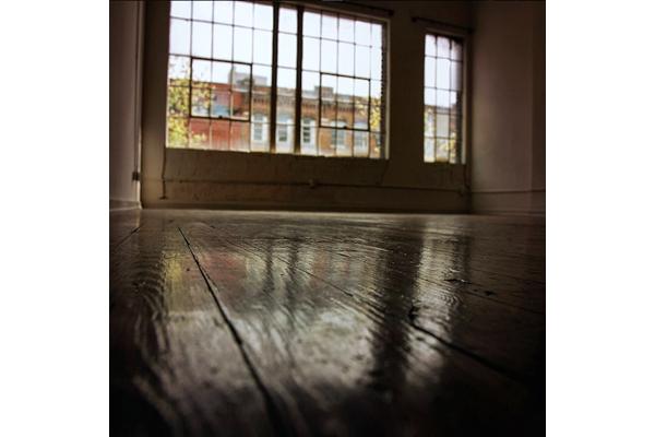 polished hardwood floors at Fix Play Lofts in Birmingham, AL 35203