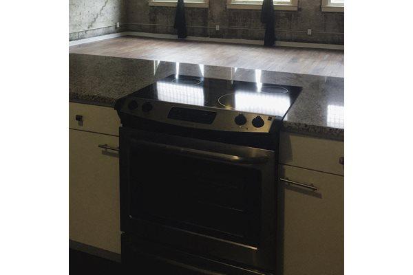 Oven in kitchen Fix Play Lofts in Birmingham, AL 35203