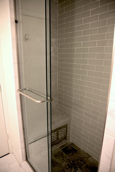 Goodall-Brown Lofts in Birmingham Alabama tile shower with glass door