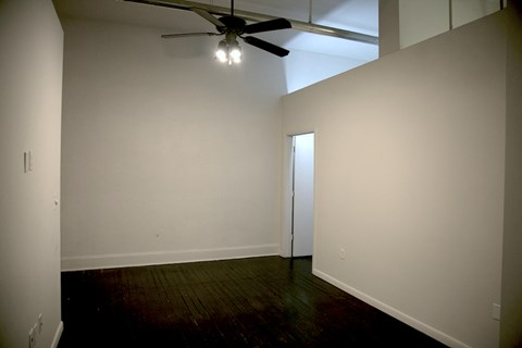 Goodall-Brown Lofts in Birmingham Alabama large bedroom with ceiling fan