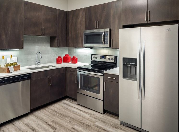 Dark Brown Shaker Style Cabinets in Kitchen at Main Street Lofts, Texas, 76063