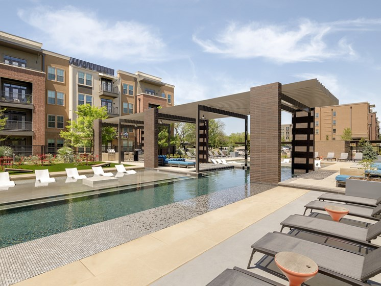 Pool with Lounge Chairs at Main Street Lofts, Mansfield, TX 76063