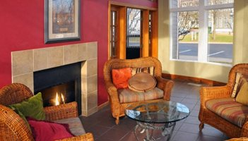 Resort Style Social Room With Cozy Fireplace
