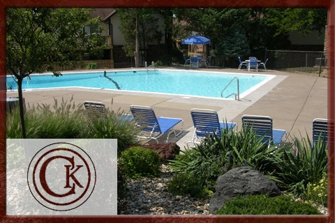 Swimming Pool with Lounge Chairs at Chateau Knoll, Bettendorf