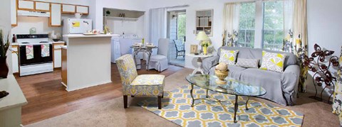 panorama of kitchen and living room at Plantations at Killearn Apartments in Tallahassee, FL 32309