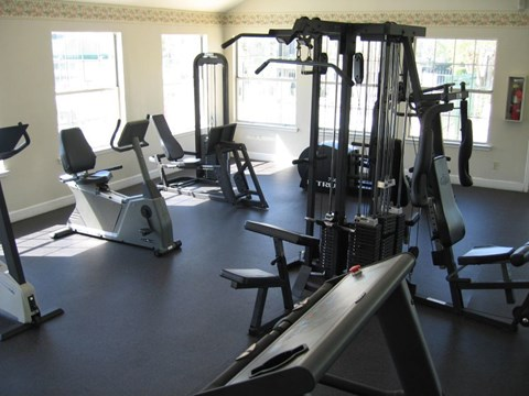 Augustine Club Apartment Homes Tallahassee FL 32301 fitness center with cardio and weight equipment