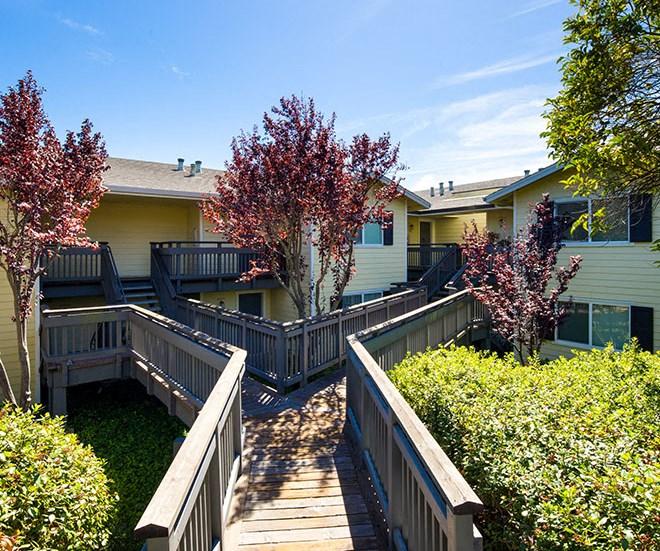 Wood Walkway to Buildings l Seabridge at Glen Cove Apartments in Vallejo, CA