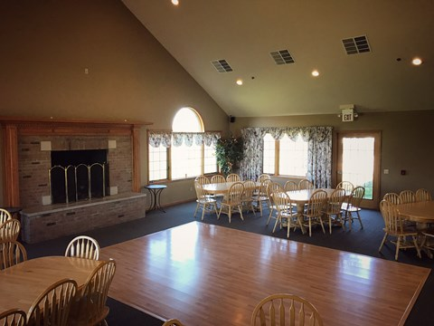 Rentable clubhouse with seating for up to 48 people with dance floor, fire place, kitchen and bar