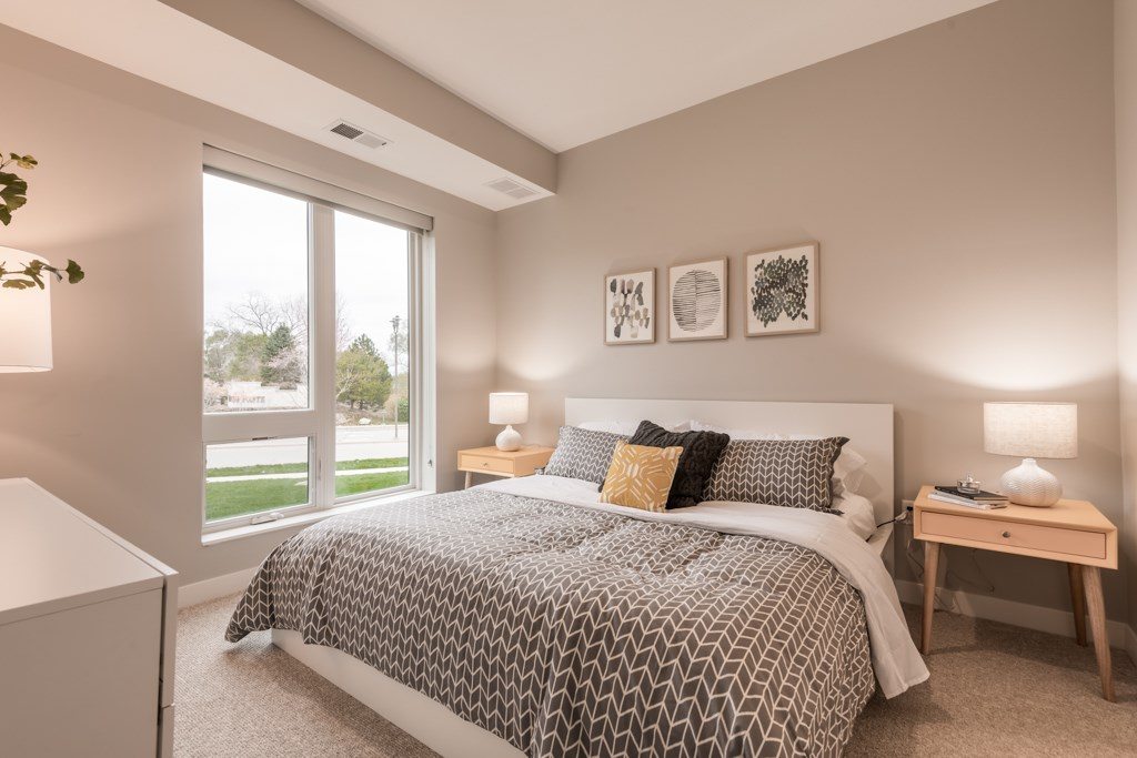 Interiors- Bedroom with natural light at The Preserve at Normandale Lake