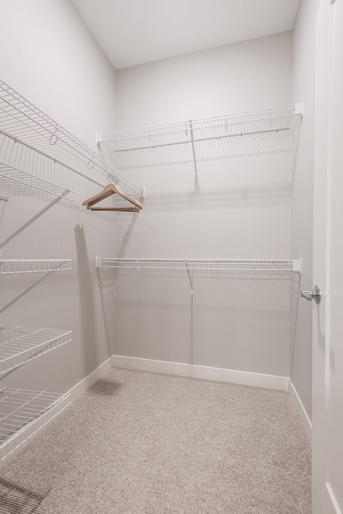 Interiors- Walk in closet at The Preserve at Normandale Lake in Bloomington, MN