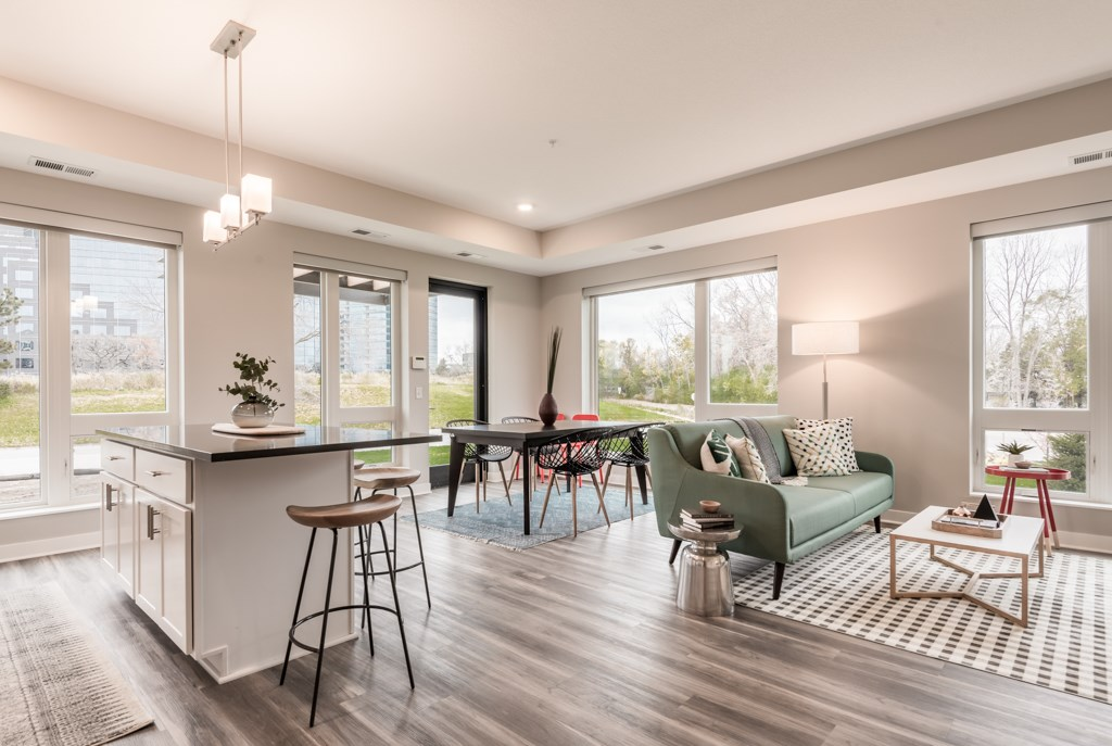 Interiors- Kitchen Island and Living Room View at The Preserve at Normandale Lake