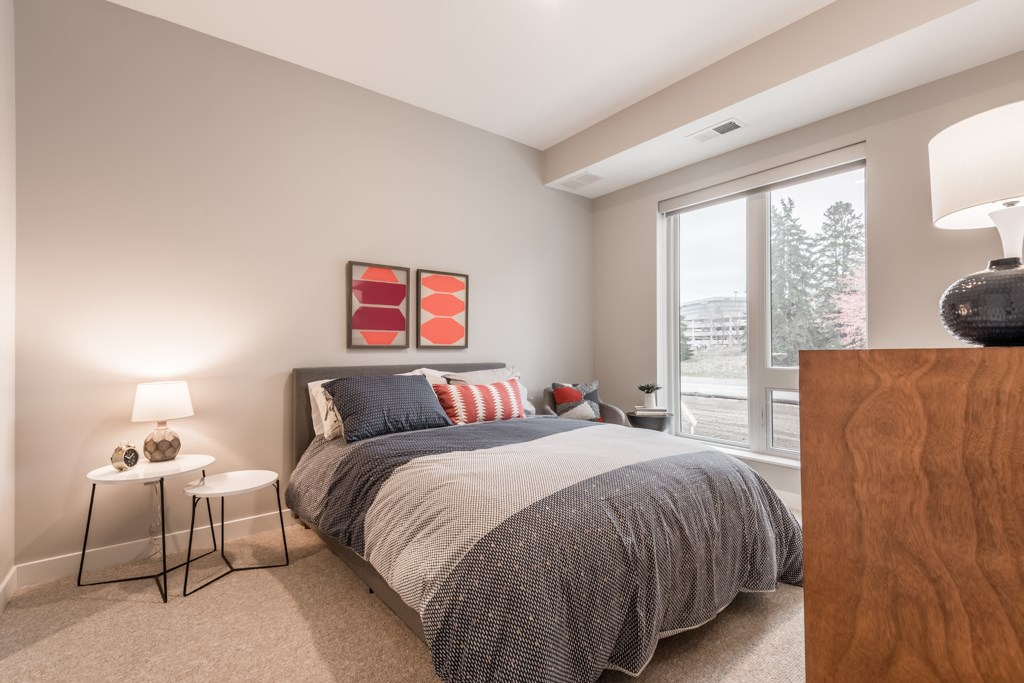 Interiors- Large bedroom with natural light at The Preserve at Normandale Lake in Bloomington, MN