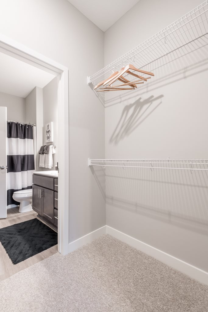 Interiors-Large walk-in closet with shelving at The Preserve at Normandale Lake