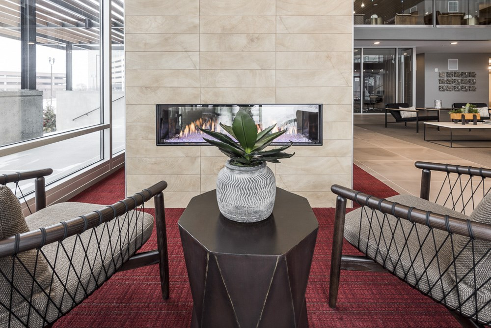 Seating next to designer fireplace at The Preserve's clubhouse