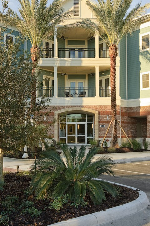 Exterior of Newberry, FL apartments with balconies and palm trees