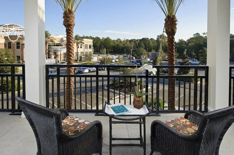 Private covered balcony with chairs at Newberry, FL apartment