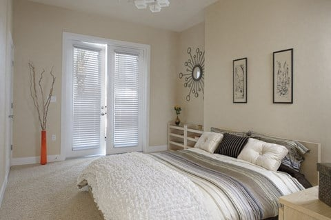 Furnished master bedroom at The Flats at Tioga Town Center in Newberry, FL