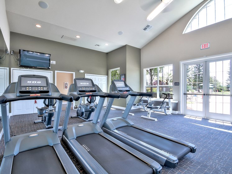 Fully body work out center includes cardio and strength training equipment.