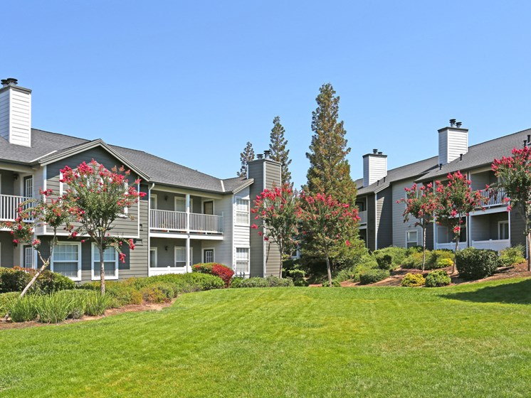 Exterior image of the property buildings. The property is Garden Style.