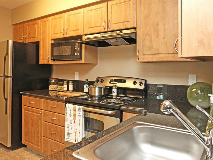 Kitchen is fully equipped with refrigerator, microwave, dishwasher, stove and range.