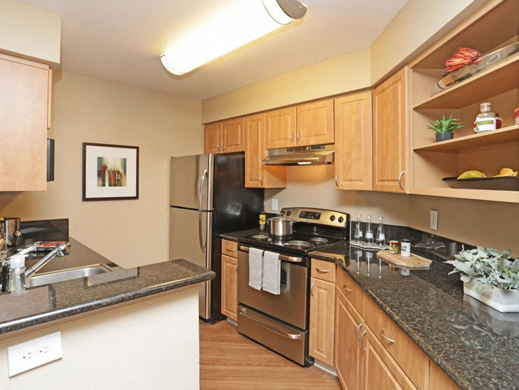 Kitchen is fully equipped with refrigerator, dishwasher, stove and range.