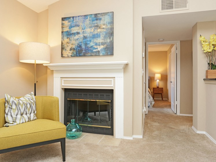 Spacious living room with fire place and plush carpeting.