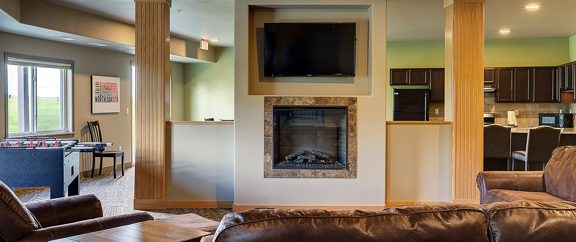 Fireplace in Community Room of Bluffs of Williston Apartments ND