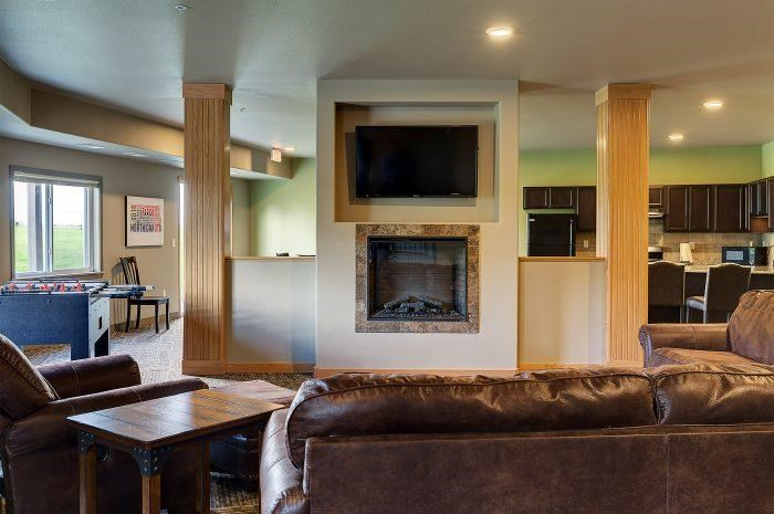 Fireplace and Community Room in Bluffs of Williston Apartments ND