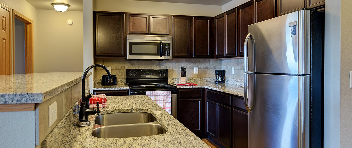 Kitchen at Bluffs of Williston Apartments ND