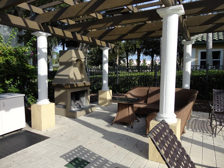 Outdoor sitting area with fireplace Allegro Palm Riverview Florida