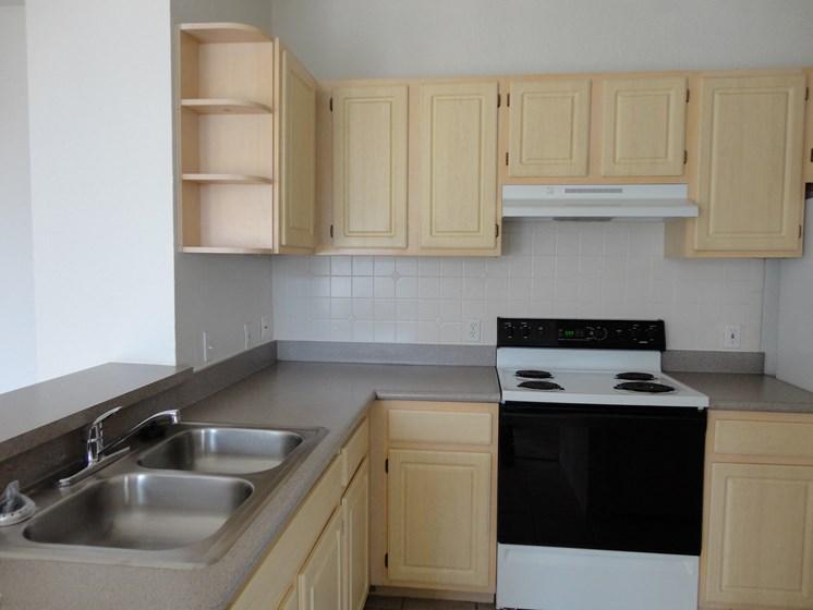 Interior Unit Kitchen Sink Counter Cabinets Stove Allegro Palms Riverview Florida