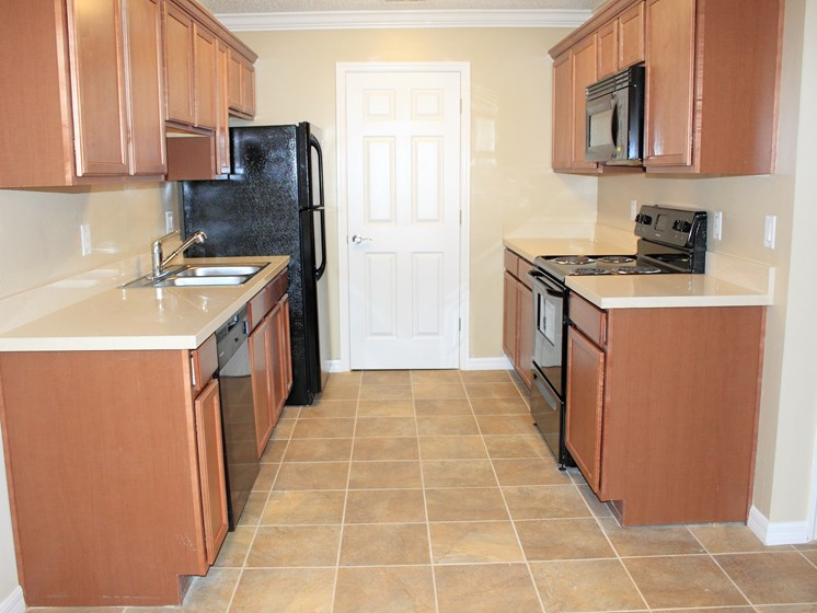 Kitchen with refrigerator oven dishwasher at Aventine Forest Lake Oldsmar Tampa Florida