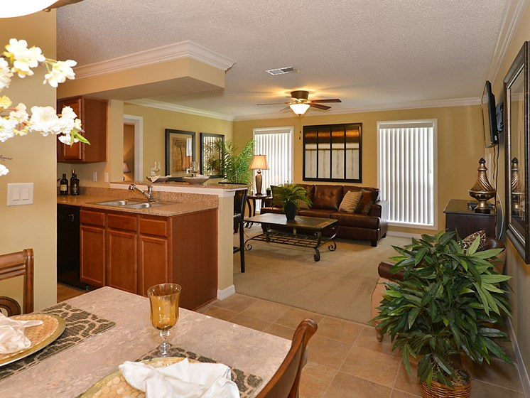 Dining room with view of living room at Aventine Forest Lake Oldsmar Tampa Florida