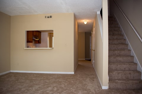 Living room with hallway at Bluff House Apartment Homes, Orange Park, 32073