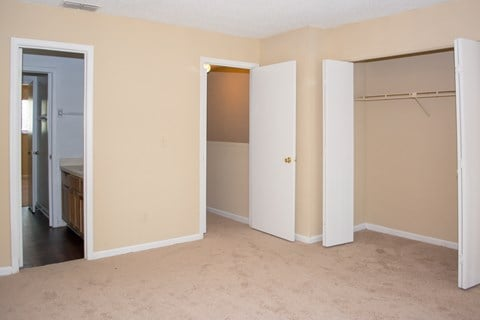 Bedroom with closet and en suite bathroom at Bluff House Apartment Homes, Orange Park