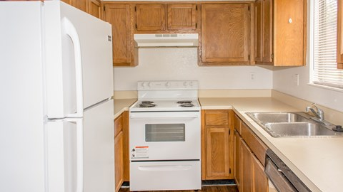 Kitchen with fridge stove at Bluff House Apartment Homes, Orange Park, Florida