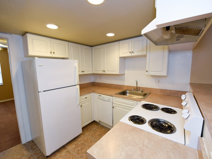 Kitchen with refrigerator, oven and dishwasher  at Green Oaks Apartments, Florida, 33616