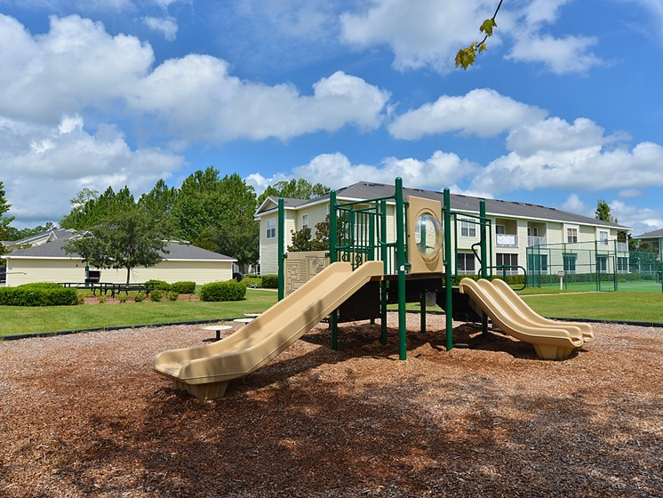 Exterior BBQ Grill and Picnic Tables Playground Tennis Courts Gainesville Florida