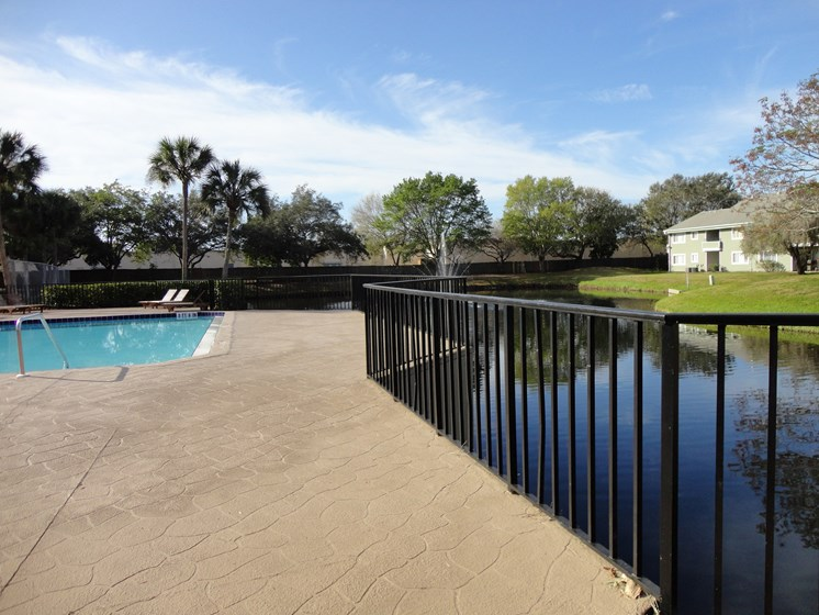 Pool with small lake on site Mira Lagos Bradenton, Florida