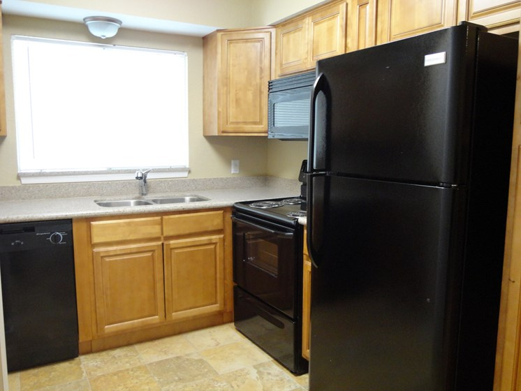Kitchen with refrigerator dishwasher oven and microwave Jacksonville Florida