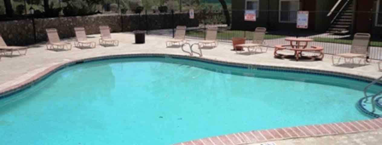 Pool with Lounge Chairs EL Paso TX 79935 l Lake Fairway Apts Rentals