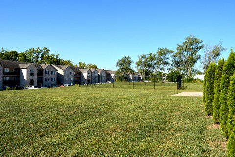 Dog park located next to apartment buildings